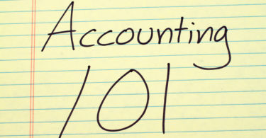 Accouting 101 written on yellow legal pad paper