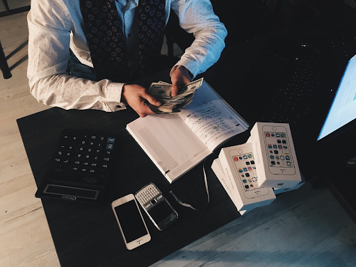 accountant sitting at a desk counting money